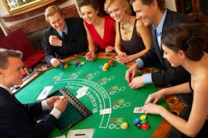 Friends playing cards on blackjack table