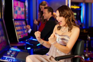 girl-on-a-slot-machine-all-obviously-are-winning-in-Las-Vegas-casino-Nevada-1600x1066